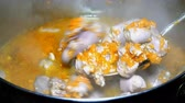 stirred : Cooking homemade food. Goulash or thick soup of chicken giblets with carrots boils in a saucepan. It is stirred with a metal spoon. Stock Footage