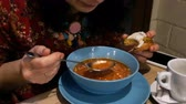 borscht : Borscht with sour cream. Stir in the cafe or restaurant. Stock Footage