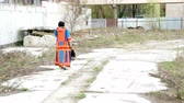 deaf : Abandoned woman walks away in abandoned place. Outdoors