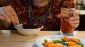 soft fruits : Vegetarian food. Meals during the post. Woman eating vegetarian food. Different vegetables. In a cafe or restaurant. Close-up.