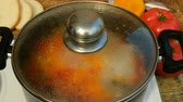 louça de barro : Homemade cooking. Concept of healthy vegetarian or lean food. Vegetable or minestrone soup cook in a metal saucepan on the stove.