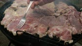 authentique : Grilled food. Meat steak. On the coals on the barbecue grill on a metal grate.