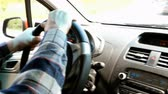 parabrezza : Man drives his car, turns the steering wheel. View from the passenger seat. Close-up. Filmati Stock