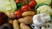 sortido : Various raw vegetables for making vegetable soup, borscht, or a vegetarian healthy meal. As well as dill, parsley and other culinary herbs. Concept of healthy eating. Stock Footage
