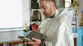 różaniec : Kiev, Ukraine, May 2019: - Young priest reads a prayer from the Bible.