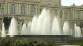 オデッサ : Large fountain gushing up water in Odessa Opera and Ballet Theater. Large city fountain, high streams of water, white splashes. Outdoors.Close-up.