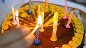 チョコレート : Human hands set fire to candles on beautiful delicious birthday cake that is on kitchen table. Maybe it was prepared for birthday celebration. Selective focus. Close-up.