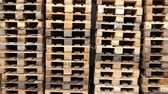 A lot stacks of used wooden pallets of euro type on warehouse is ready for recycling. Industrial background. Close-up.