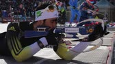 attentiveness : Martin Fourcade on firing line at Biathlon