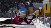 attentiveness : Kaisa Makarainen and Darya Domracheva on firing line at Biathlon
