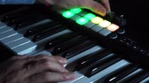 compositor : Musician playing MIDI keyboard    MIDI controller synthesizer in concert - selective -focused piano keys closeup for electronic music production  recording  live concert