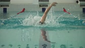 pływak : athlete swimmer swims in the pool slow motion front view.