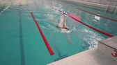 exercises : male athlete swims in the pool Stock Footage