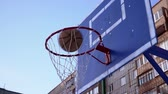 on the basketball court the ball hits the basketball Hoop