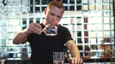 hipster : brutal bartender burning Sambuca at the bar Stock Footage