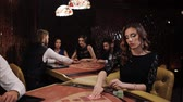 style : Woman in Black Dress Takes the Card and Makes a Bet in a Casino, Blakjack