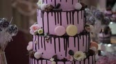 смаковать : multi-tiered wedding cake with cupcakes and macaroon