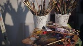 watercolor : Dirty Palette Knives And Brushes in Art Studio. Art concept. Painting Stock Footage
