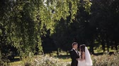 evlenmek : bride and groom dance outdoors in the park.