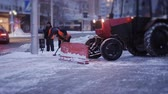 kaygan : Cleaning car plowing snow to the side of the street. Cleaning the side of the road after a snowfall.