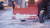 carregador : Snow plow outdoors cleaning street. snowplow removing fresh snow from city square