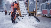 municipal services : municipal snow removal machine grabs snow from the street