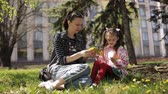 věnec : mother weaves a wreath of dandelions for her daughter. her daughter delivers mom lowers.