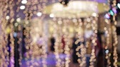 сияющий : Bokeh of lights and garlands in the background dancing people Стоковые видеозаписи