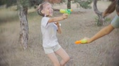 holi : Little girl laughing her head off as she enjoys a water fight - slow motion