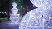 otomobil : Christmas, New year time in city streets, decorated and illuminated. Stok Video