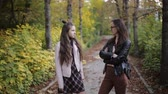 beco : Mother and daughter talking in autumn Park.