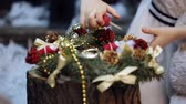 papai noel : Two little girls at a Christmas tree prepare a gift for the grandmother Vídeos