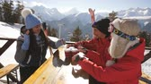 bebida quente : Group of happy friends cheering with drink after skiing day in cafe at ski resort Stock Footage