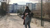 prole : Little girl with backpack running from school to meet his mom and hugging her. Stock Footage