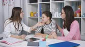 exame : Advice in the doctors office. A mother and daughter a teenager on the medical examination. A doctor examines a sore throat, the girl of the patient.