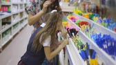 用品 : Purchase of school supplies. Mother and daughter in supermarket stationery.