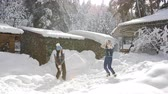 ハグ : Playful couple having fun outdoors, young girls throws up the snow. Winter joy. 動画素材