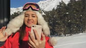 The ski resort. Woman making selfie on smartphone in the cabin ski lift.