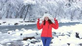 harikalar diyarı : Happy woman in winter landscape near a mountain river and enjoys the outdoors and is happy.