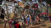 terai : Bardia, Nepal - January 16, 2014: Traditional carousel in fairground during Maggy festival in Bardia, Nepal