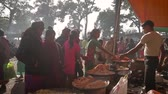 eyer : Bardia, Nepal - January 16, 2014: Preparing local food in a fairground Maggy festival in Bardia, Nepal Stok Video