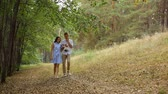 buty : young couple walking in the woods on the track with his cat.