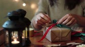 свеча : Young Woman Wrapping Christmas Gifts With Brown Paper At Home