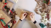 sustentável : Top view woman wrapping christmas presents With Brown Paper At Home Vídeos
