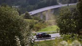 switzerland : Aerial View. Car on a winding road in the hills. Alps Switzerland