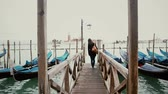 setembro : Woman walking on dock at Grand Canal in Venice, Italy on September, 2013