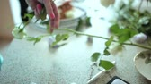 leaf : Florist prepares flowers for a floral composition