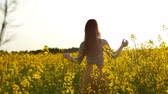 environmental : girl walks through field, straightens hair slow mo