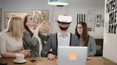 augmented reality : handsome man takes off glasses virtual reality after using new app share experiences with team in the startup office. Stock Footage