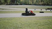 gokart : Kart drivers moving on a go kart track. Stock Footage